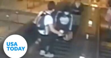 NYPD looking for man caught on video kicking a woman down an escalator | USA TODAY